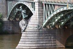 Art Nouveau statue carrying torches, Cechuv Bridge over the Vlta Stock Images