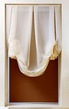 Art nouveau style curtain in window frame Stock Photo