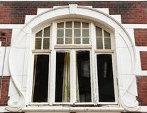 Art nouveau window at a city house in Roermond, Netherlands. Picture of an art nouveau window at a city house in Roermond, Netherlands royalty free stock images