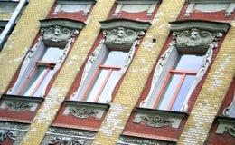 Art Nouveau windows. Beautiful Art Nouveau windows on a brick wall Royalty Free Stock Images