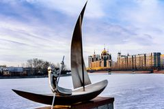 View from the embankment in Astana. Art object on the Ishim River in the center of Astana in the winter time Stock Image