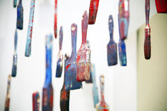 Art objects painty brushes hanging in the air Royalty Free Stock Photo