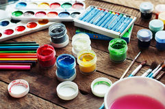 Free Art Of Painting. Paint Buckets On Wood Background. Different Paint Colors Painting On Wooden Background. Painting Set: Brushes, Pa Royalty Free Stock Image - 63598356