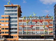 Art on office building. Colorful artistic human figures on the side of an office building, Mediahafen, Dusseldorf, Germany Royalty Free Stock Photo