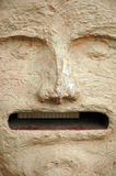 The art of the old days. Human head carved in stone royalty free stock image