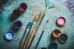Artist paint brushes and paint cans of paint over. Art paint artist brushes cans colors group royalty free stock photos
