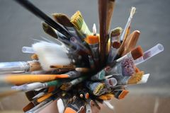 Art paint brushes. colorful brushes in pot stock photos