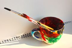 Art paint brushes in a cup with empty space for text stock photography