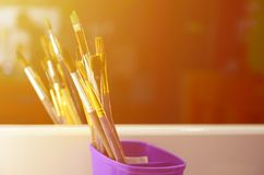 Art paint brushes in cup are located in the children's entertain. Ment hall at the mirror stock image