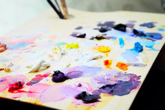 Art paint palette with brushes and paints Royalty Free Stock Photography