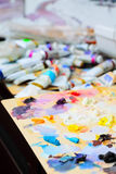 Art paint palette with paints Royalty Free Stock Photos