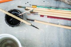 Art Paintbrush, Pottery painting tool. Black Color and Paintbrush, Pottery painting tool for handcraft artist Stock Photo