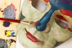 Art of Painting - Painting a Mask Royalty Free Stock Photo