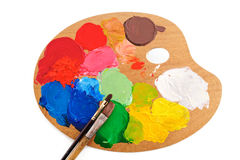 Art Paints. Two paintbrush on the palette with bright acrylic paints Royalty Free Stock Photos