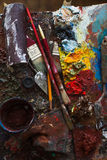 Art paints, palette, brushes pencil. Darck tone Stock Photos
