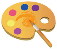 Art palette. Wooden art palette with blobs of paint and a brush on white background with clipping path Stock Images