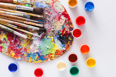 Art palette with colorful paint strokes, isolated Stock Photography
