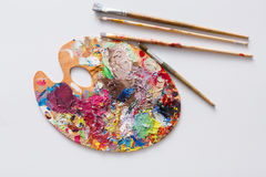 Art palette with colorful paint strokes, isolated Stock Photos
