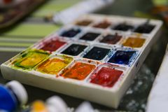 Art Palette with Colorful Paints Close Up View. Open Aquarelle Watercolor Palette at Art Studio Open Space. Artist Work stock images