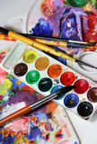 Art palette and mix of paintbrushes Royalty Free Stock Photo