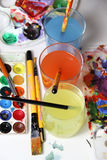 Art palette and mix of paintbrushes Stock Photos