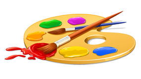 Art palette with paint and brushes Royalty Free Stock Photo