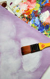 Art palette and paintbrushes Stock Images