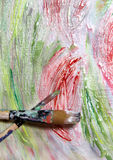 Art palette, paintbrushes and picture with flowers Stock Images