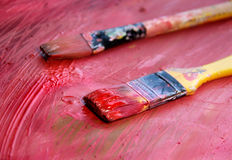 Art palette with paintbrushes and strokes Royalty Free Stock Photo