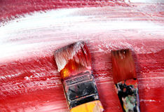 Art palette with paintbrushes and strokes Stock Photos