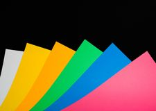 Art paper. Colorful art paper sheets on a black background royalty free stock photo