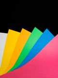 Art paper. Colorful art paper sheets on a black background royalty free stock image
