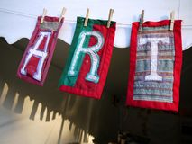 ART patchwork cloth letters. Hanging from tent entry Royalty Free Stock Photos