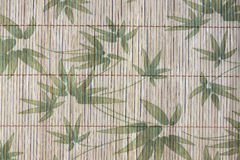 Art of pattern bamboo leaves on a wood background. Stock Photography