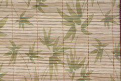 Art of pattern bamboo leaves on a wood background. Stock Photo