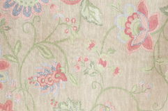 Art pattern fabric Texture. A pattern of flowers and branches of the linen cloth Stock Images