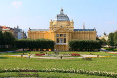 Art pavilion in Zagreb. During summer,park landscape with flowers and benches Royalty Free Stock Photo