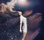 Art photo of the ballet dancer among colorful dust Stock Images