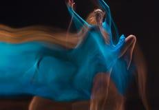The art photo-emotional dance of beautiful blue woman Royalty Free Stock Photo