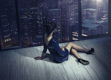Art photo of the girl in the apartment in the skyscraper Royalty Free Stock Photography