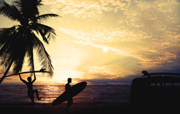 Art photo styles of silhouette surfer on beach at sunset. Vintage color tone Royalty Free Stock Image