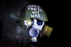 Art picture of a military gas mask. On a white brick wall with shadows with flash on Fatherland defender day stock image