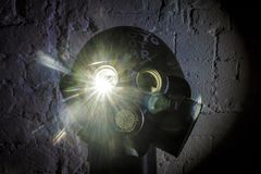 Art picture of a military gas mask on a white brick wall with shadows with flash with the inscription make photo not war on. Art picture of a military gas mask royalty free stock photos