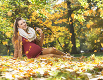 Art picture of pregnant lady under the leaves rain Stock Photography