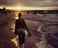 Art picture of woman with the sunset in the background Stock Photos