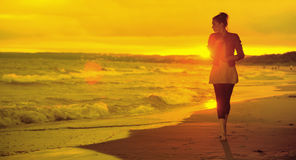 Art picture of woman, waves and sunset Stock Image