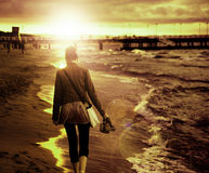 Art picture of young woman walking by the seaside Stock Photography