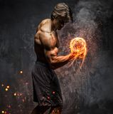 Portrait of a man with burning dumbbell. Art portrait of a man with burning dumbbell royalty free stock photo