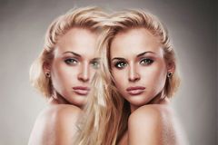 Art portrait of young beautiful woman.Sexy Blond girl. two girls in one Stock Photos