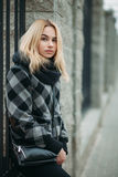 Art portrait of a young blonde woman in a in plaid jacket Royalty Free Stock Images